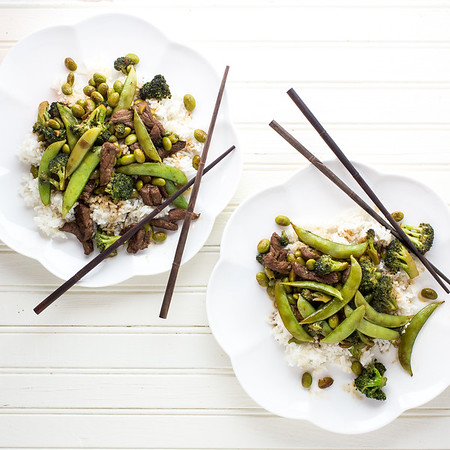 Plate of beef with broccoli and snow peas