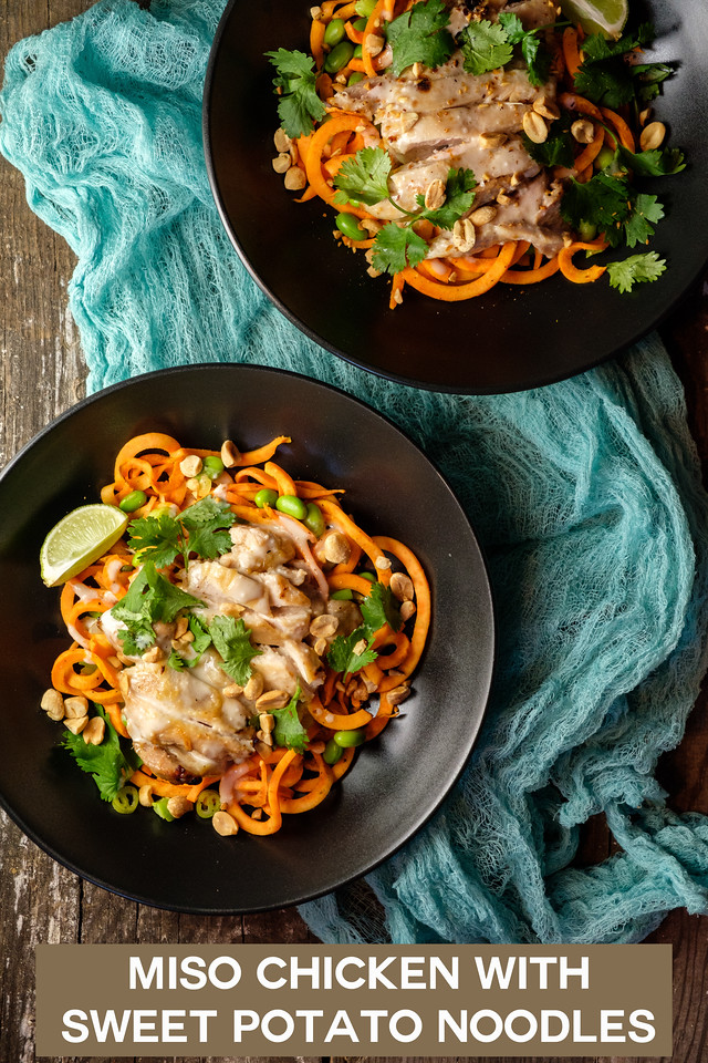 Two bowls of spiralized sweet potatoes topped with miso chicken