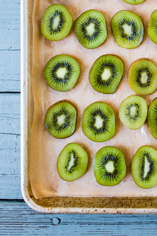 Slices of kiwi on a baking sheet