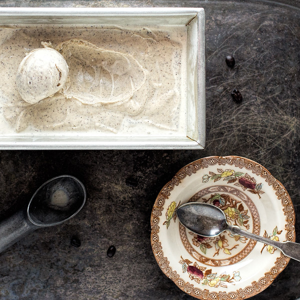 Bowl next to a loaf tin filled with coffee ice cream.