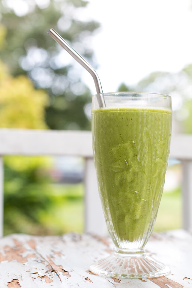 antique glass filled with a green smoothie