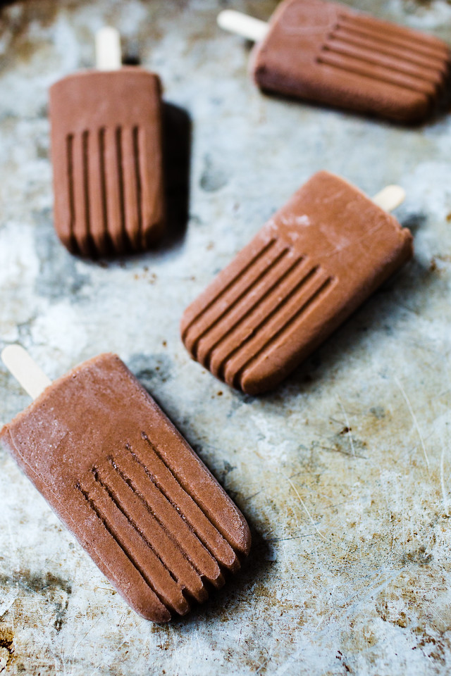 Chocolate popsicles on a metal tray
