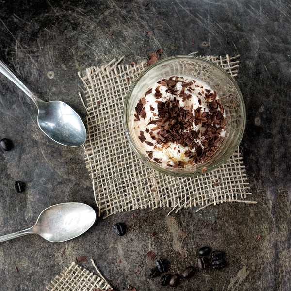 Glass of affogato with chocolate shavings and two spoons