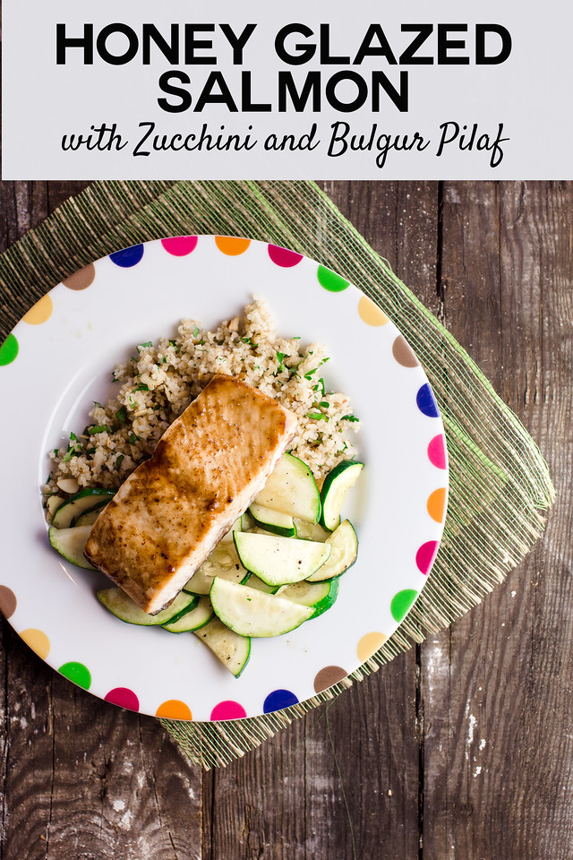 Plate of salmon with zucchini and bulgur pilaf on wooden background with text overlay Honey Glazed Salmon