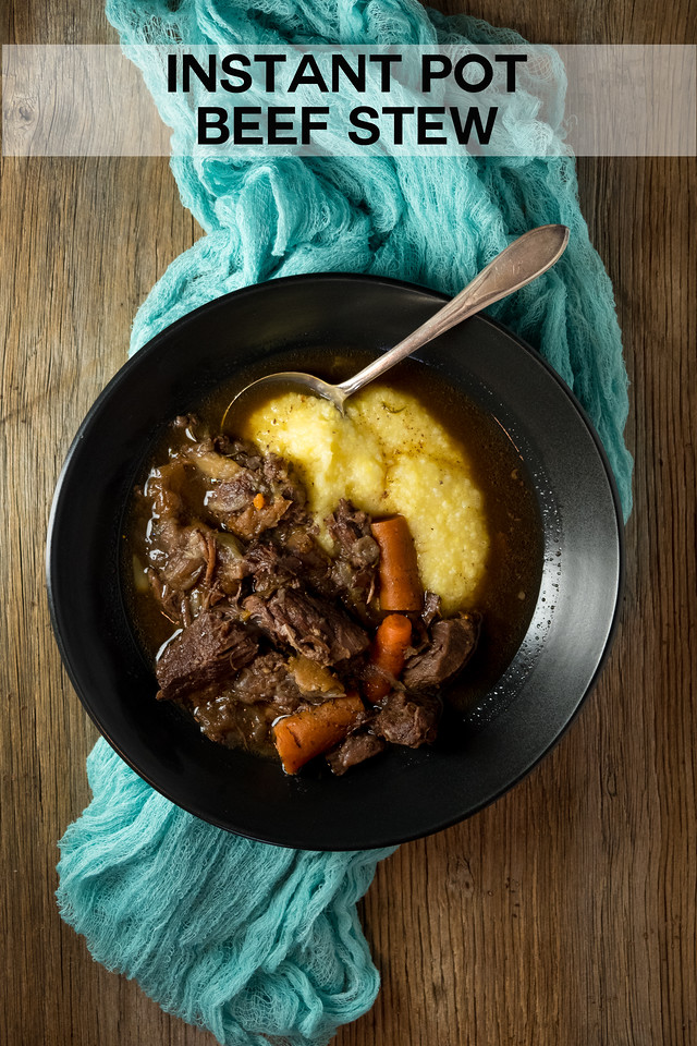 Bowl of beef stew with carrots and polenta on a brown background with a blue scarf and text overlay reading Instant Pot Beef Stew
