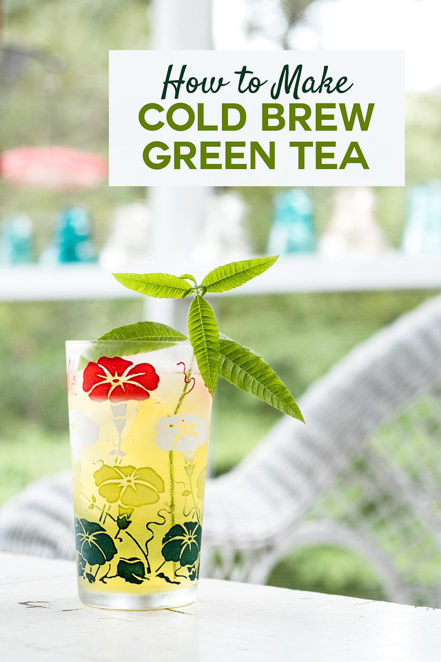 Vintage glass filled with green tea on table on screened in porch.
