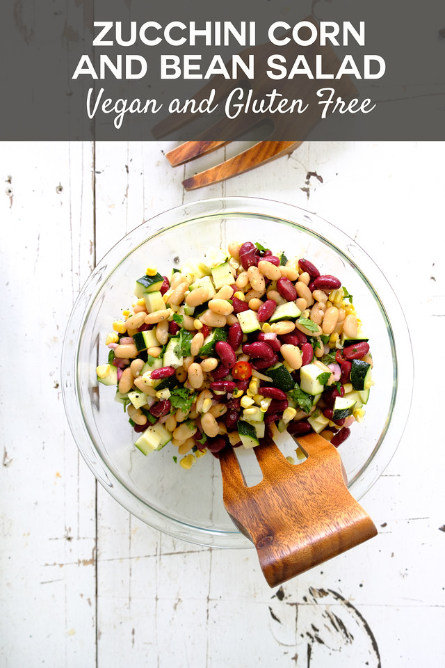 bowl of zucchini salad with text overlay reading zucchini corn and bean salad