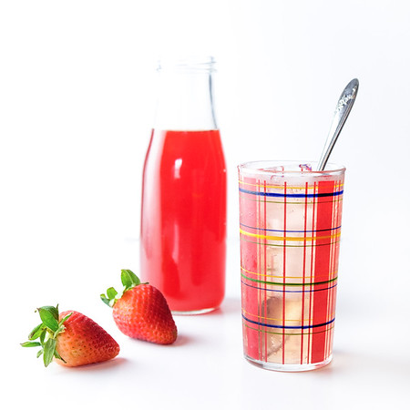 Glass of drinking shrub - Strawberry Lime Drinking Vinegar