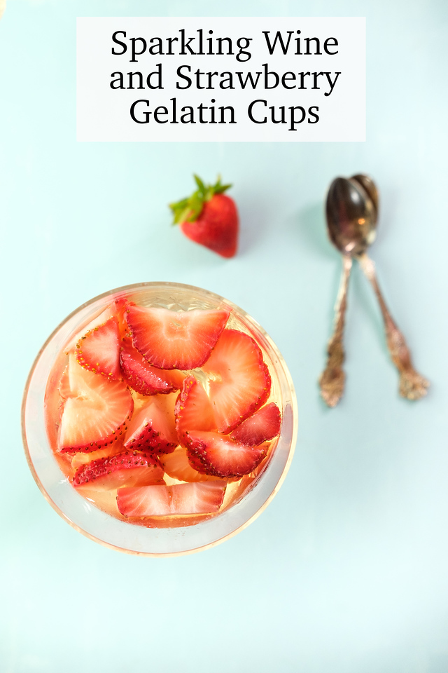 Strawberries in a glass with the text Sparkling Wine and Strawberry Gelatin Cups
