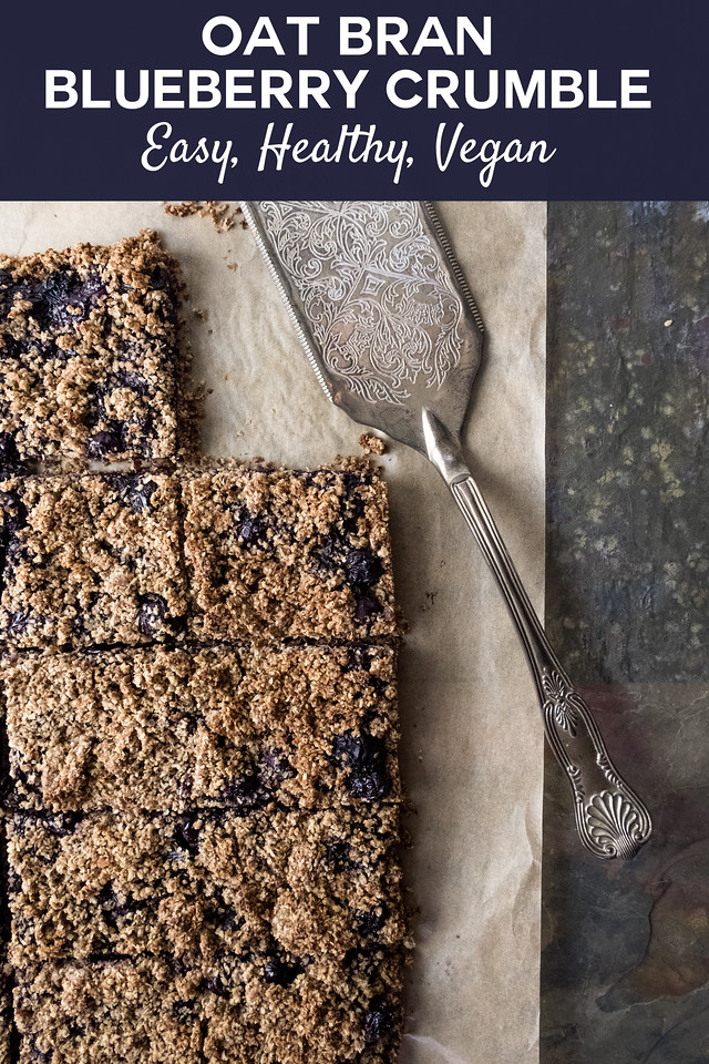 dark brown blueberry bars with text overlay reading Oat Bran Blueberry Crumble