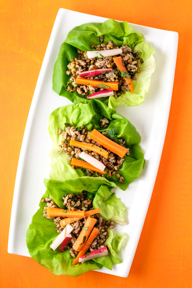 Instant Pot Pork Lettuce wraps on a white plate with an orange background