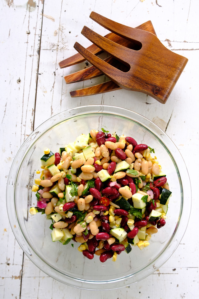 Bean salad in a bowl with wooden salad tossers