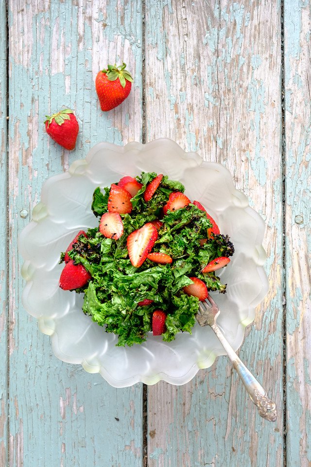 Kale salad on a plate with strawberries