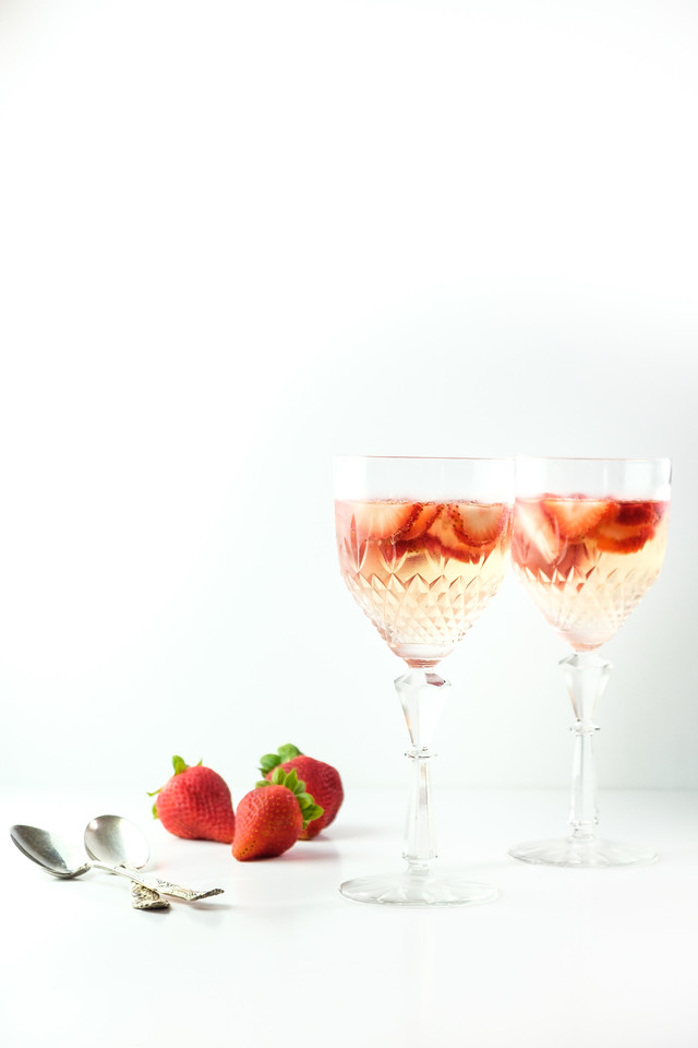 Strawberry gelatin in pretty antique glasses with strawberries