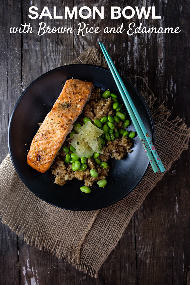 Bowl of brown rice with salmon, edamame, pickled ginger with text overlay reading Salmon Bowl