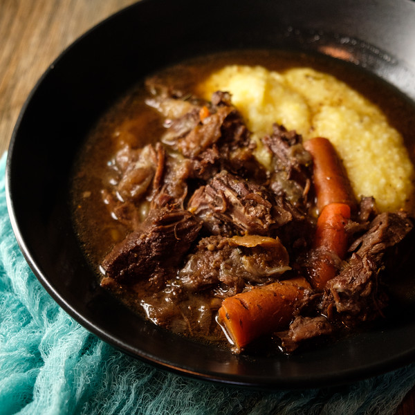 Red Wine Beef Stew in a black bowl.