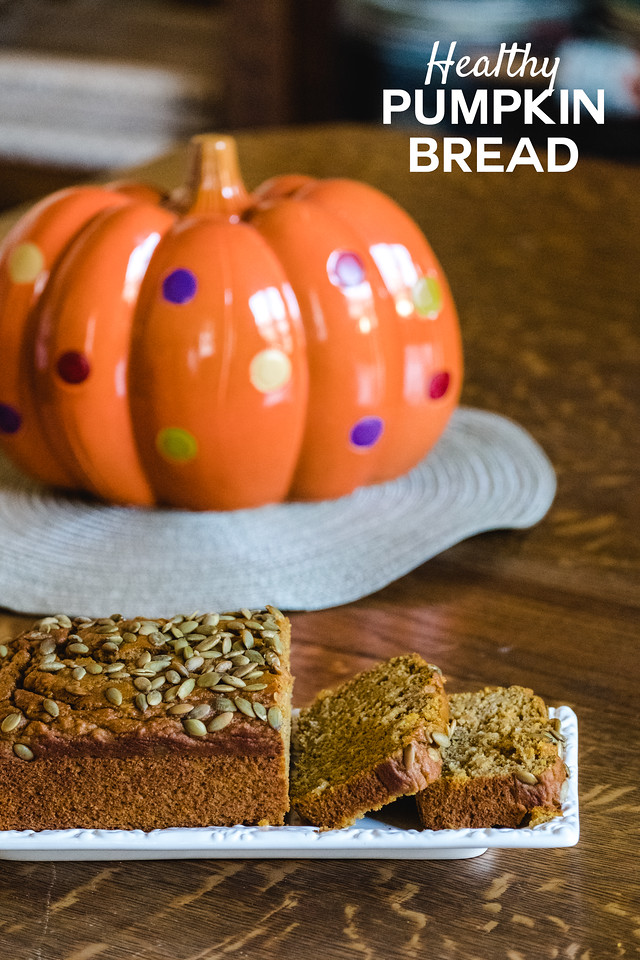 Sliced pumpkin bread in front of a ceramic pumpkin with text overlay reading Healthy Pumpkin Bread.