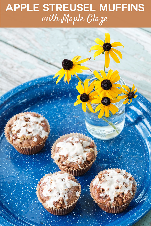 blue tray with muffins and a vase of flowers with text overlay reading Apple Streusel Muffins with Maple Glaze