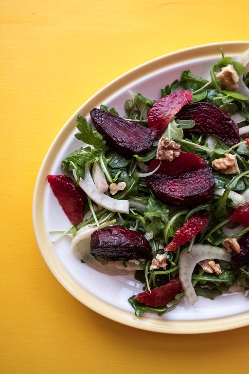 roasted beets, fennel, watercress, walnuts, blood oranges on a white plate for this Superfood Salad
