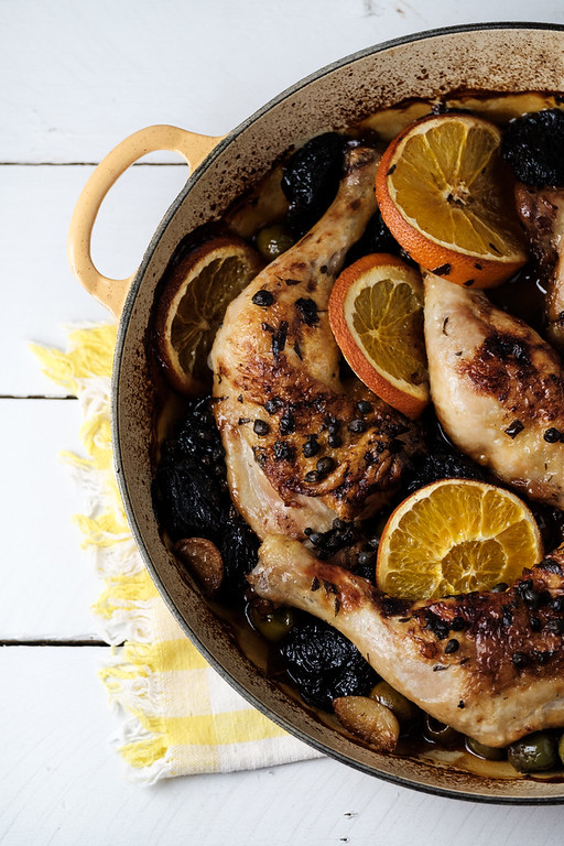 Skillet with chicken and orange slices.