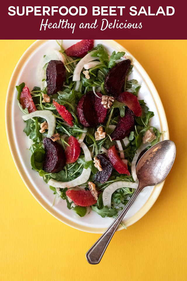Plate of roasted beet salad with text overlay reading superfood beet salad