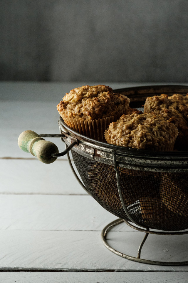 Basket of muffins on a dark gray background
