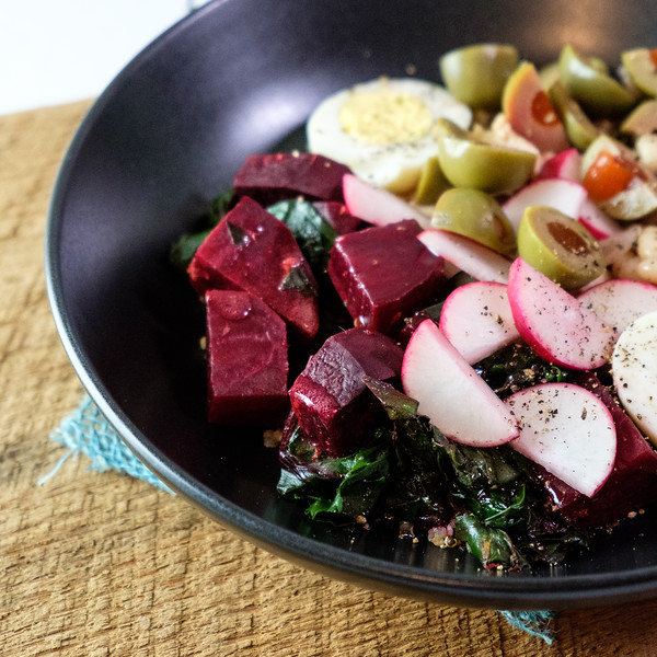 Close up of beets and radishes in tuna quinoa bowl.