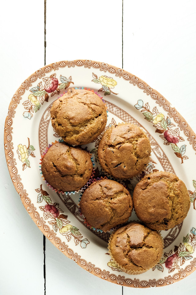 6 orange muffins on a vintage platter