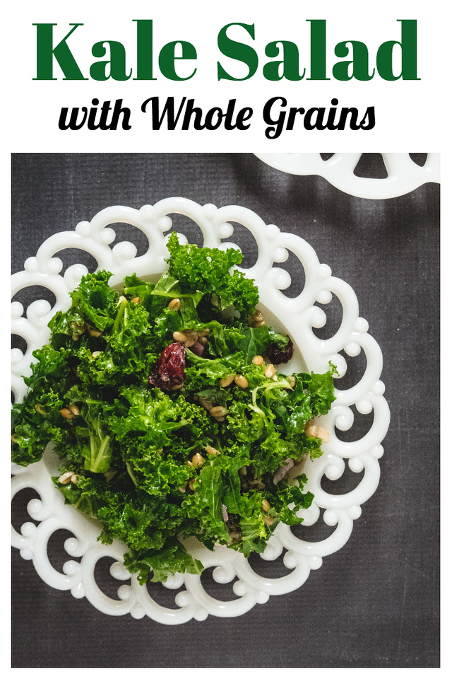 White scalloped plate with a dark green kale salad.