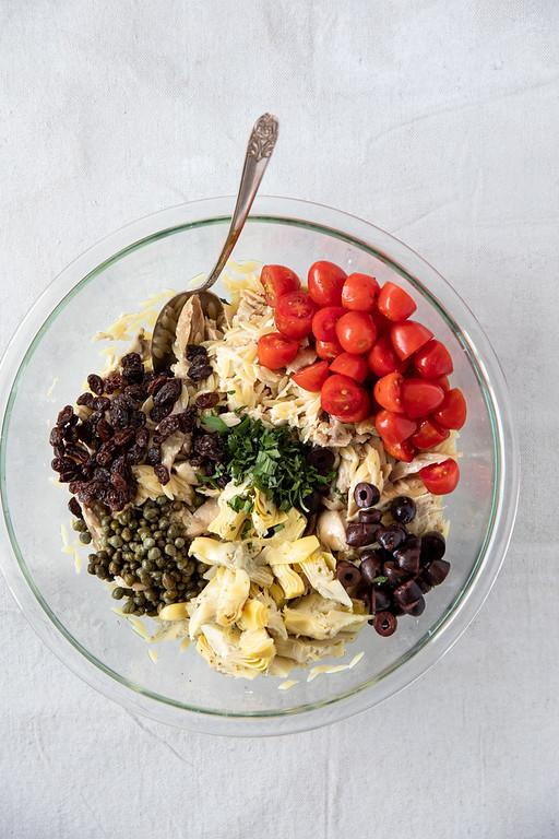 Ingredients to make Mediterranean Chicken Salad in a bowl.