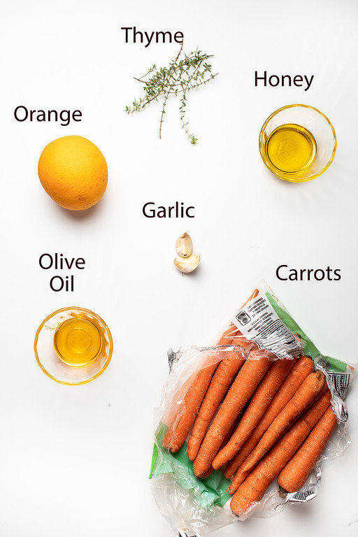 Thyme, orange, honey, garlic, olive oil and carrots to make honey orange roasted carrots.