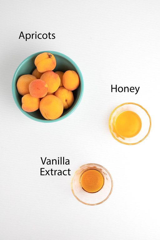 Apricots, honey, vanilla extract - ingredients to make an apricot fruit compote.