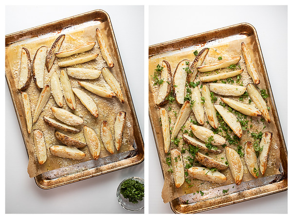 Baked fries out of the oven sprinkled with Parmesan cheese and parsley.