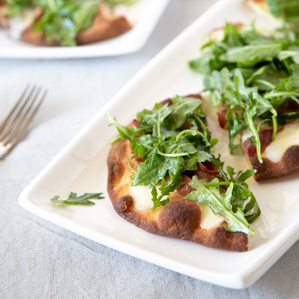Close up of Prosciutto Pizza with Arugula