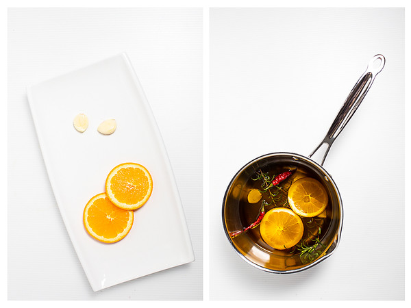 Plate with orange slices and garlic and olive oil being infused.