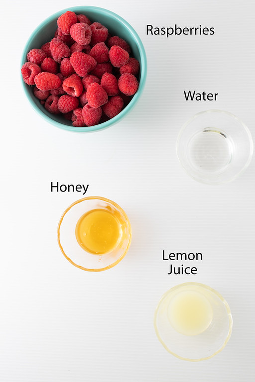 Raspberries, water, honey, lemon juice - to make a raspberry fruit compote.