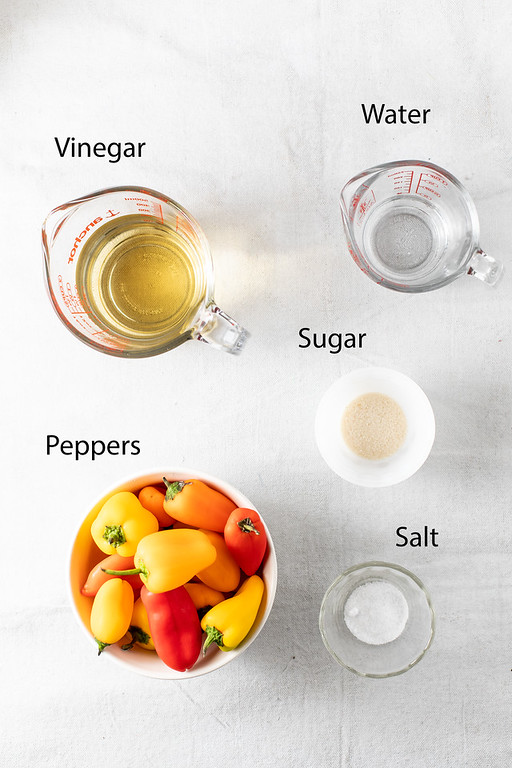 Vinegar, water, sugar, salt and peppers - to make pickled peppers.