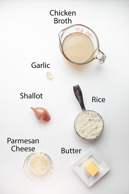 Chicken broth, garlic, shallot, rice, Parmesan cheese and butter to make parmesan rice.