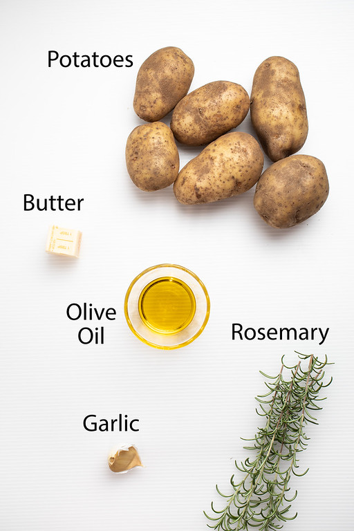 Potatoes, butter, olive oil, garlic and rosemary for skillet fried potatoes.