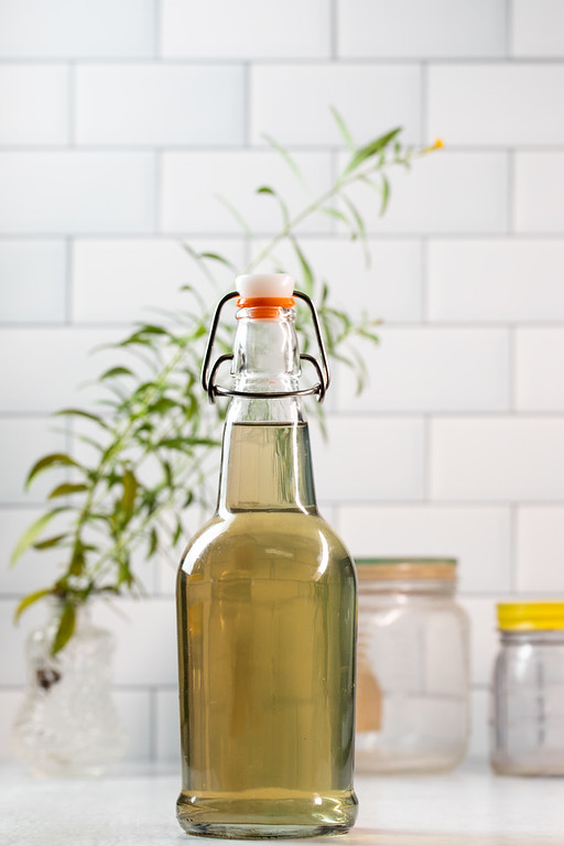 Bottle filled with herbed vinegar.