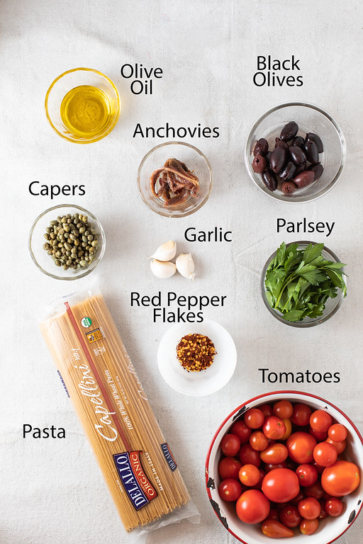 Ingredients needed to make pasta puttanesca.