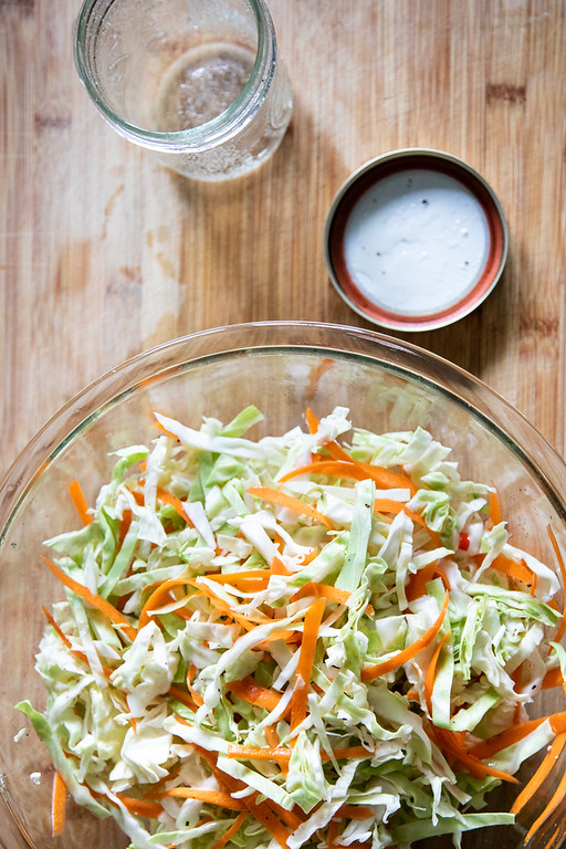 Bowl of shredded cabbage and carrots.