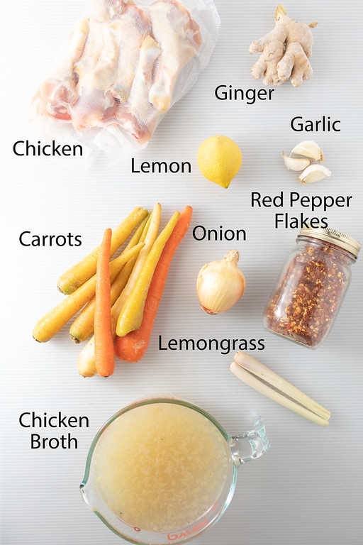 Ingredients for thai chicken soup on a white background.