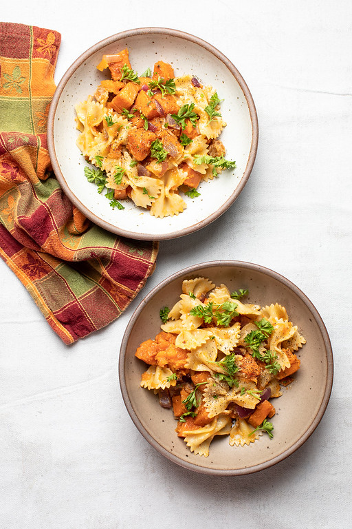 Two bowls of Pasta with sweet potatoes.