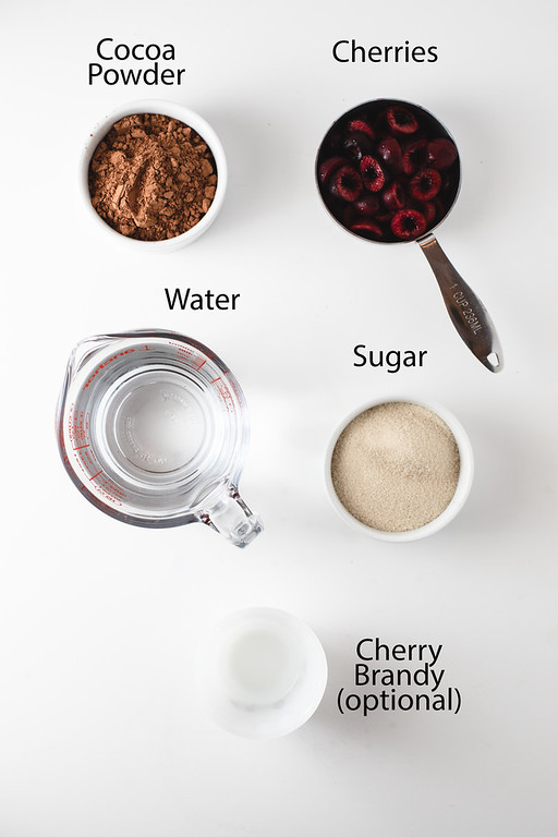 Ingredients to make cherry chocolate sorbet - cocoa powder, cherries, water, sugar and cherry brandy.