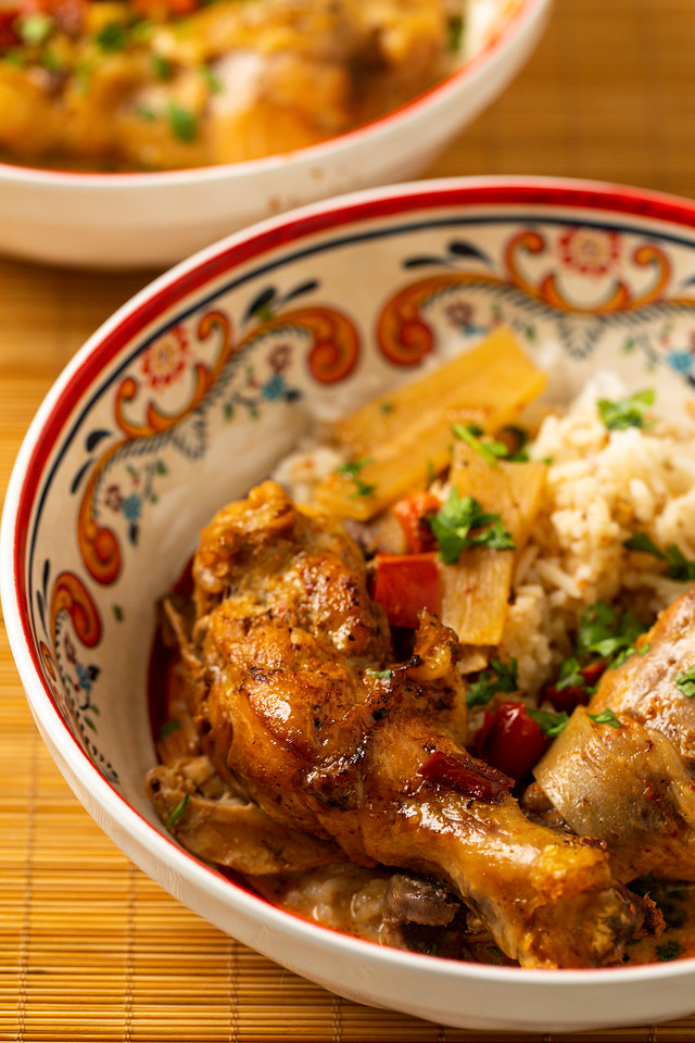 Curried chicken in a colorful bowl served with rice.