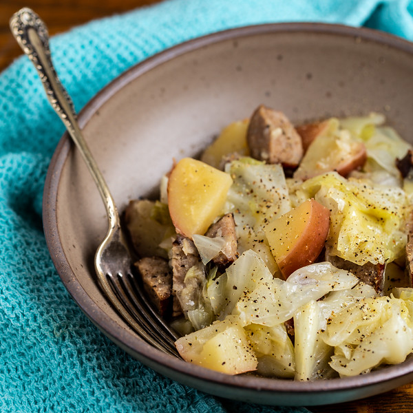 Bowl of sausage, potatoes and cabbage.