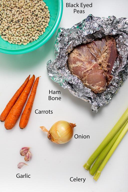 Black eyed peas, ham bone, carrots, celery, onion, and garlic.