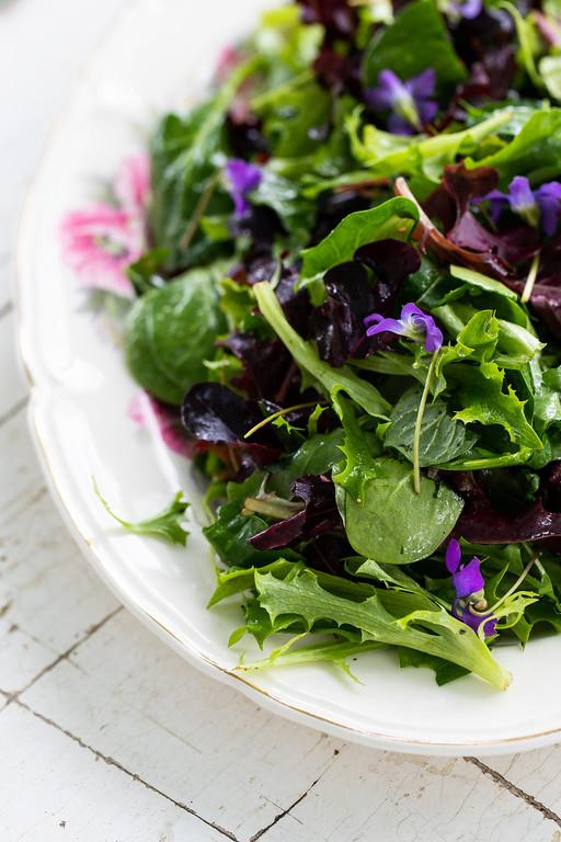 Close up of an herb salad on a platter.