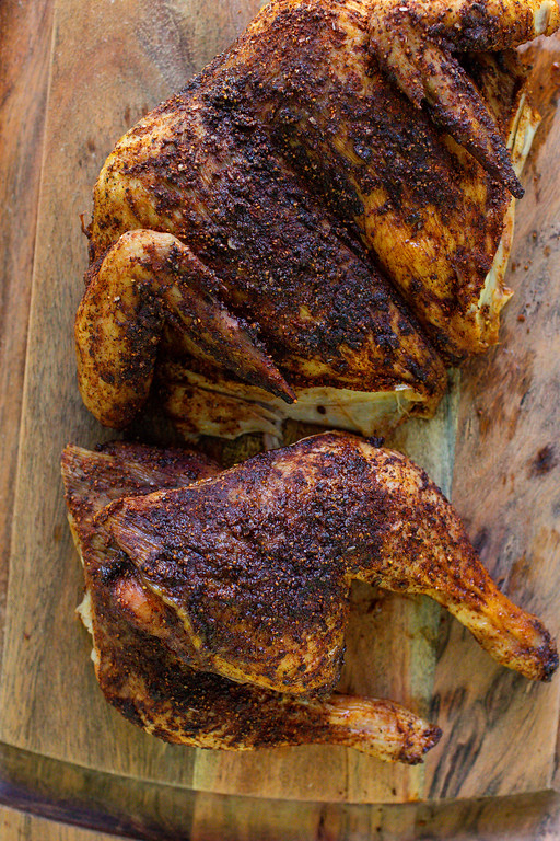 Grilled chicken covered in a deep red rub.